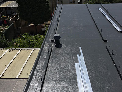laying a new Fibreglass Roof Southampton