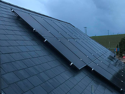 Slate roof with solar panels in Plymouth