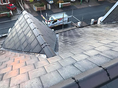 Works van from the top of a new roof prenton
