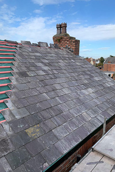 replacing slates on a roof in warrington
