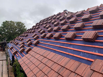 tidy roofer southport