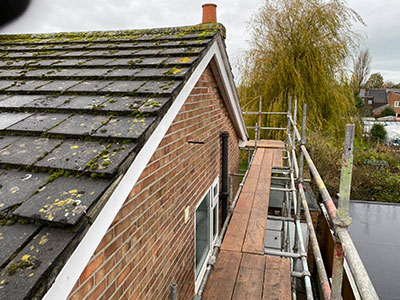 Work starts on this old tile roof